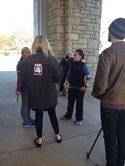 Local Fox 4 News interviews participants at Loose Park.
