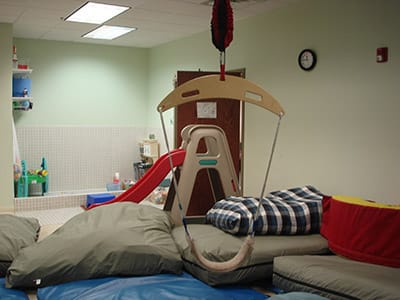 The gym at Therapy Connections for Kids has swings, crash pillows, slides and a ball pit.