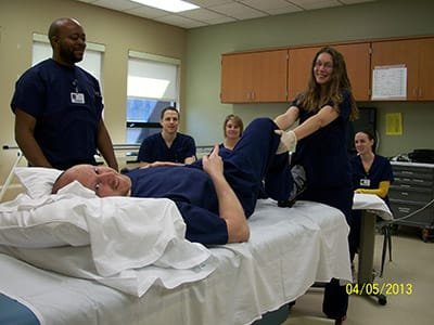 Kristina Pekovic, at the end of the bed, is a recent PTA Clinical Affiliation student who completed her in-service on joint mobility with RehabCare at Kindred Hospital – Indianapolis. Also pictured are Jeff Paris (Kristina's supervisor on the mat), Duane Alexander (rehab tech), Corey Rheinhardt (rehab tech), Tracy Rutherford (OTR) and Lauren Meyer (PTA student).