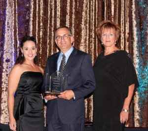 Anthony Disser, Kindred's Senior Vice President of Clinical Operations, Hospital Division accepted the 2012 Hospital Partnership Award. Also pictured: DaVita's Lynn Robinson (left) and Joanne Brady (right).