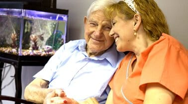 Resource Library Care at Home image of caregiver and older man smiling