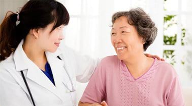 Resource Library Stroke Recovery image of smiling doctor and older woman