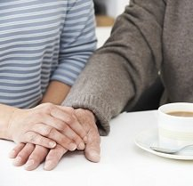Image of older couple holding hands