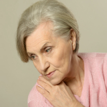 Senior woman with acontemplative look on her face