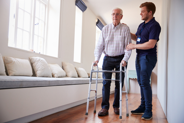 image of a senior man learning to use his walker with his occupational therapist