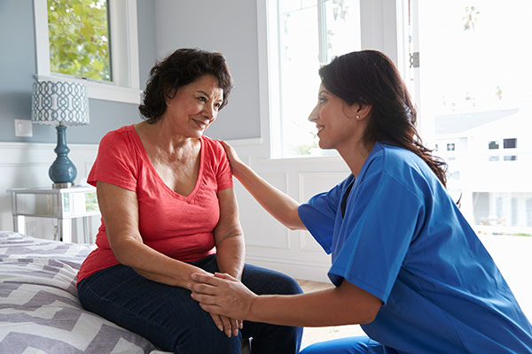image of a home health nurse visiting a woman at home