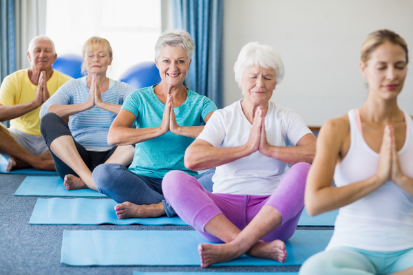 Image of adult women practicing yoga