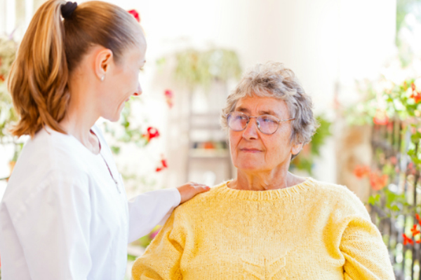 image of a woman speaking with her hospice nurse