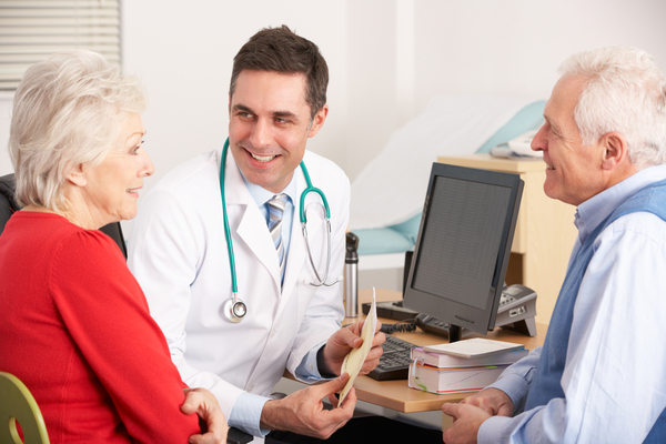 Man and wife discussing lung health with a physician
