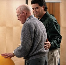 Senior man walking with his physician to work on balance